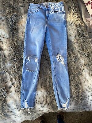GIRLS LIGHT BLUE RIPPED SKINNY JEANS FROM NEW LOOK AGE 13yrs