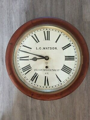 An Attractive Vintage Oak Round Wall Clock  Railway/School Style with Key