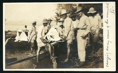 1911 Artura Real Photo Postcard Carrying away Some of the wounded to Australia