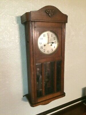 antique clock with  wooden case surround