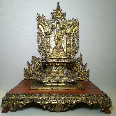 Antique Thai bronze Buddha. 19th-20th century. The object has a wooden base.