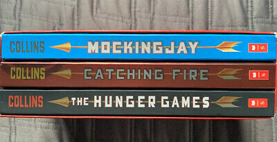 The Hunger Games Trilogy Collection by Suzanne Collins (2014) -Read Description