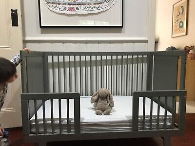 Oeuf Sparrow Cot and Toddler Bed - Grey. Used. Paint wear (pictured).
