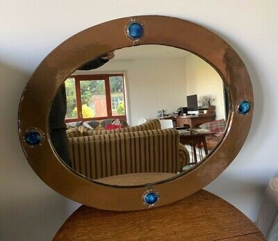 Excellent Oval LIBERTY & CO Arts and Crafts copper mirror with Ruskin Roundels