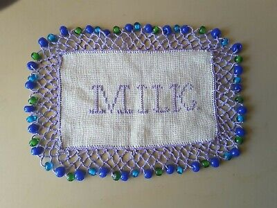 Vintage  beaded milk jug cover with the word MILK