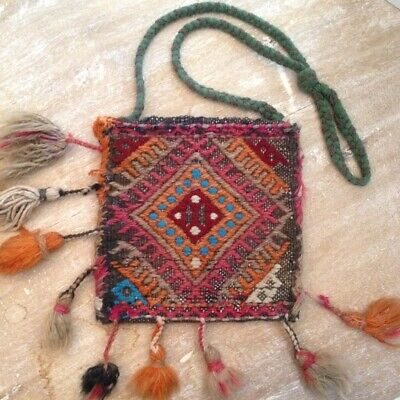 Bag made from ancient folkloric woven and embroidered wool carpet