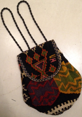 Rucksack made from ancient folkloric woven and embroidered wool carpet used old