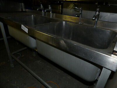 Stainless catering table with double sinks. 2.14m wide