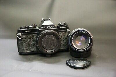 Pentax Mv 35mm Film SLR camera with 50mm f2 prime lens caps etc Serviced