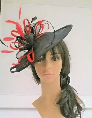 NEW BLACK WITH RED SINAMAY & FEATHER FASCINATOR HAT.Shaped saucer disc,Wedding.