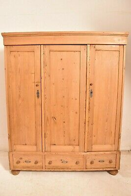 A 20th Century Pine Triple Armoire Wardrobe
