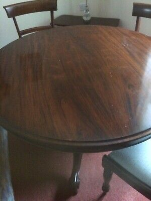 antique mahogany victorian tilting table & 4 upholstered chairs