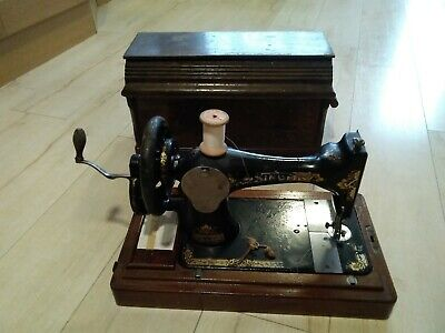 Vintage Singer Sewing Machine with additional needles and thimbles
