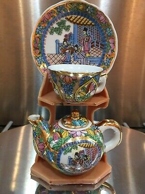 Chinese Mini Teapot Cup And Saucer Set On Stand