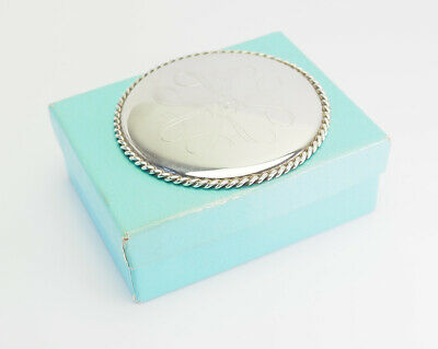 Elegant vintage sterling silver purse hand mirror by Tiffany & Co