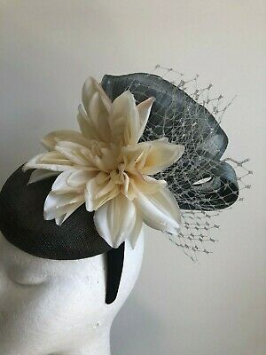 New grey fascinator with silk abaca loops, flowers and netting on a headband