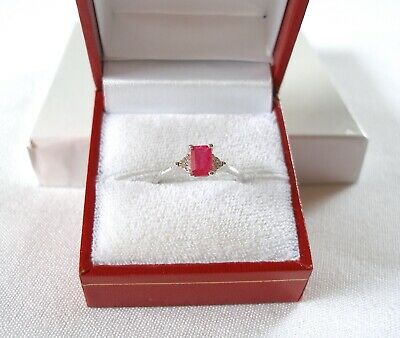 CELINE F. - .70 Ct. Ruby Solitaire & Diamond  10k White Gold Ring