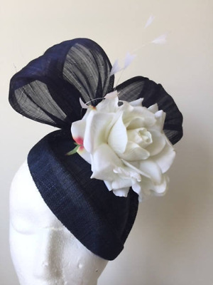 Stunning navy fascinator with silk abaca loops, white feathers and flower.