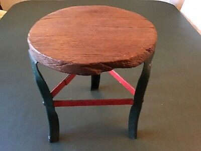 Vintage Milking Stool With Metal Legs And A Wooden Seat.