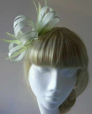 Light green fascinator on headband for wedding/mother of the bride/races