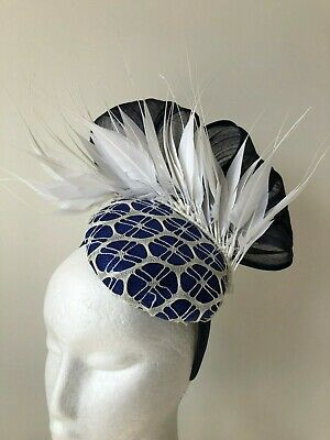 New cobalt blue fascinator with white netting, feathers and navy loops!
