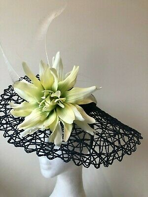 Navy basketweave fascinator with flower and feathers on a headband!