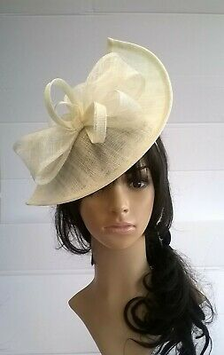Ivory Fascinator shaped sinamay with Bow loops & feathers Wedding