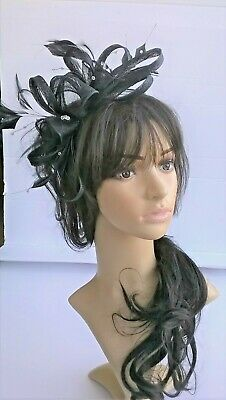 Black Feather Fascinator..rosette on a headband..for wedding races.crystals