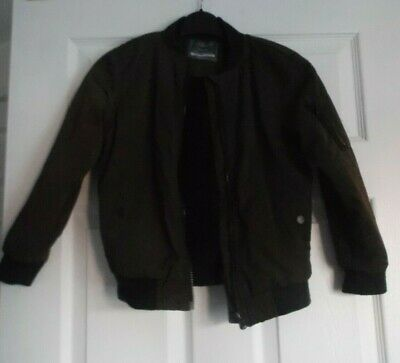 Primark childs coat 6-7yrs dark khaki fleecy lined Pockets zip pocket on sleeve