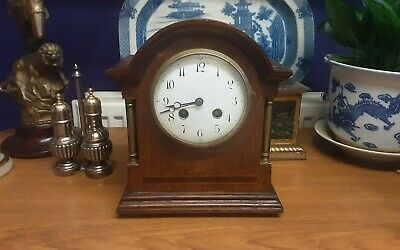 Antique French inlaid mantel clock with brass columns