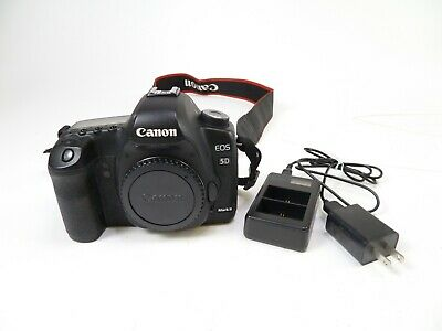 Canon 5D Mark II w/ a Shutter Count of 140,444, Battery, Charger, Cap and Strap.