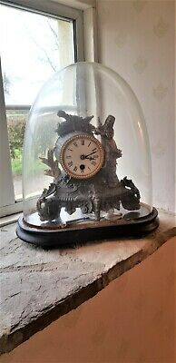 French, late 19th century gilt spelter clock in glass dome