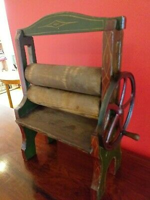 Childrens ANTIQUE childs toy small MANGLE miniature painted wood , METAL WHEEL