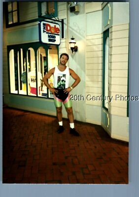 Found Color Photo B_8144 Man Posed Under Dole Sign With Hands On Hips
