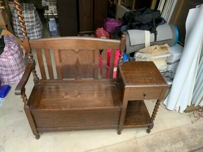 Antique hall/seat stand with bench-seat, storage, and hooks.