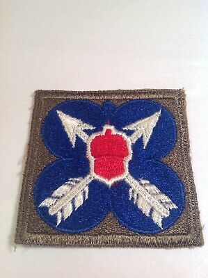 Vintage Patch With White Arrows, Red Acorn, And Blue Background