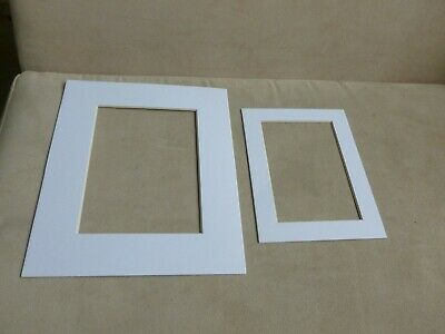 2 nice thick quality white bevelled picture  mounts 1-26x21&1-19x14cm outside