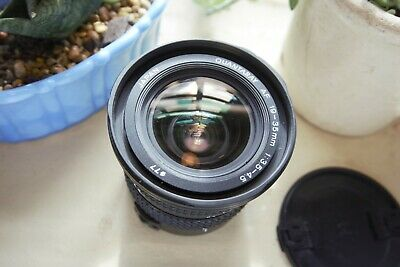 Quantaray 19-35mm f/3.5-4.5 Lens For Canon w/ 2 77mm UV filters