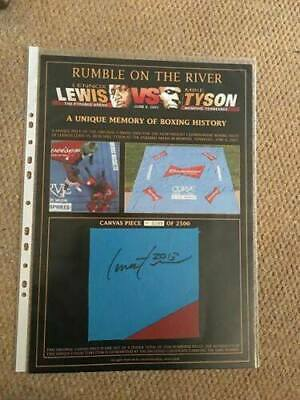 MIKE TYSON vs LENNOX LEWIS. ACTUAL PIECE OF RING CANVAS. SIGNED BY LEWIS