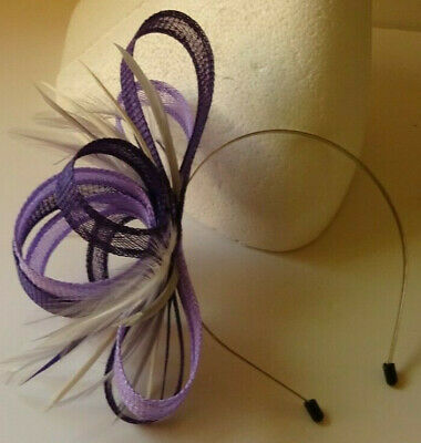 Purple/lilac fascinator on headband for wedding/mother of the bride
