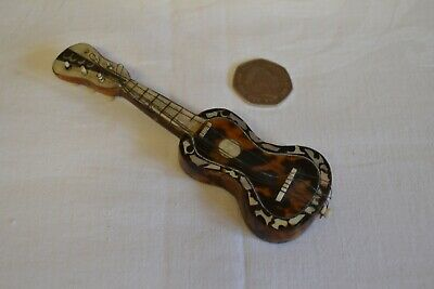 Antique tortoiseshell and mother of pearl guitar miniature