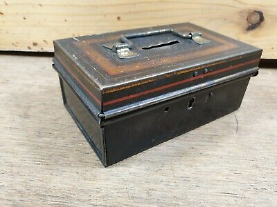 Vintage money tin with handle and lock.  Small collectable money box project.