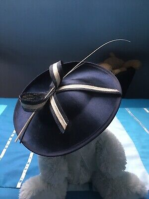 navy and cream hat syle fascinator with bow and decoration on hairband