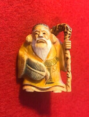 """JAPANESE SIGNED NETSUKE OF OLD MAN WITH CANE and BASKET IT IS 2"""" tall"""