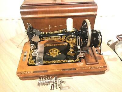 Frister and Rossmann Handcrank Sewing machine with attachments/Accessories