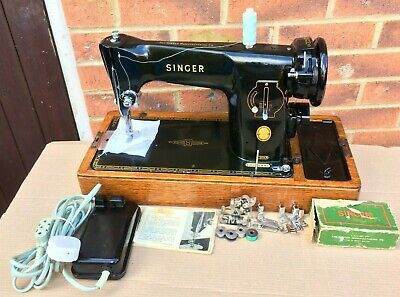 Singer 201K antique Sewing Machine with paper clip decals and attachments.