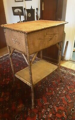 Antique Victorian or Edwardian bamboo table with storage compartment