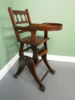 An Antique Interesting Early 20th Century Child's High Chair Rocker Roller ~Deli