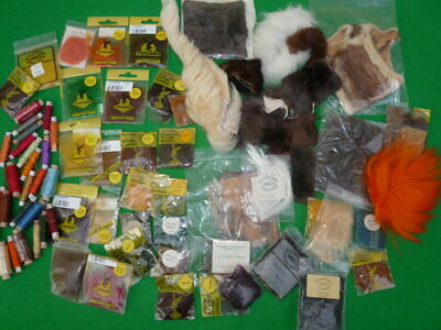 A collection of new old stock fly tying materials including Venyard seals fur