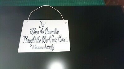 SPECIAL FAMILY MEANING  WALL HANGING SIGN IN WHITE WITH BLACK VINYL LETTERS.